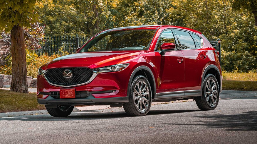 Consumer Reports recommends the 2020 Mazda CX-5 like this crossover SUV parked on street