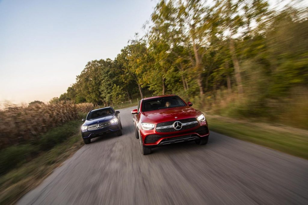 2020 Mercedes-Benz GLC300 driving with another GLC300