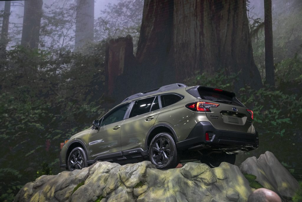 2020 Subaru Outback displaying capability with staged photo on top of a cliffside