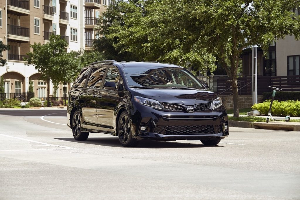2020 Toyota Sienna driving around apartment buildings