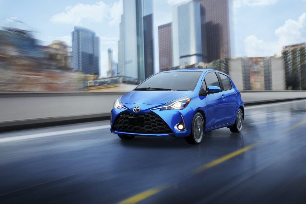 A blue 2020 Yaris driving on the track