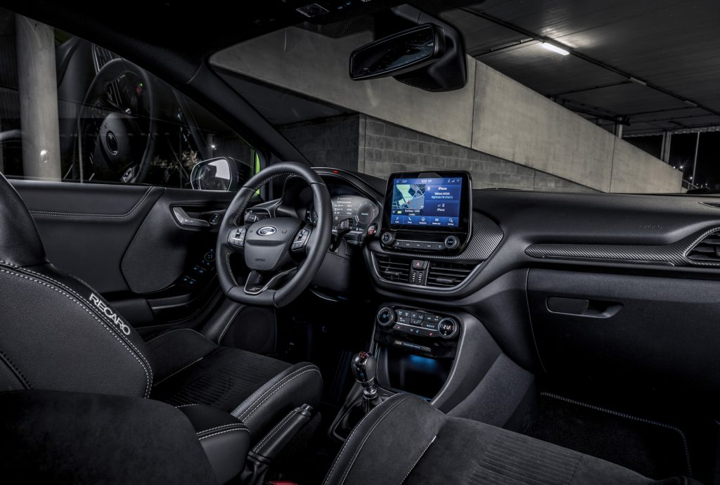 The black Recaro front seats and black dashboard of the 2021 Ford Puma ST