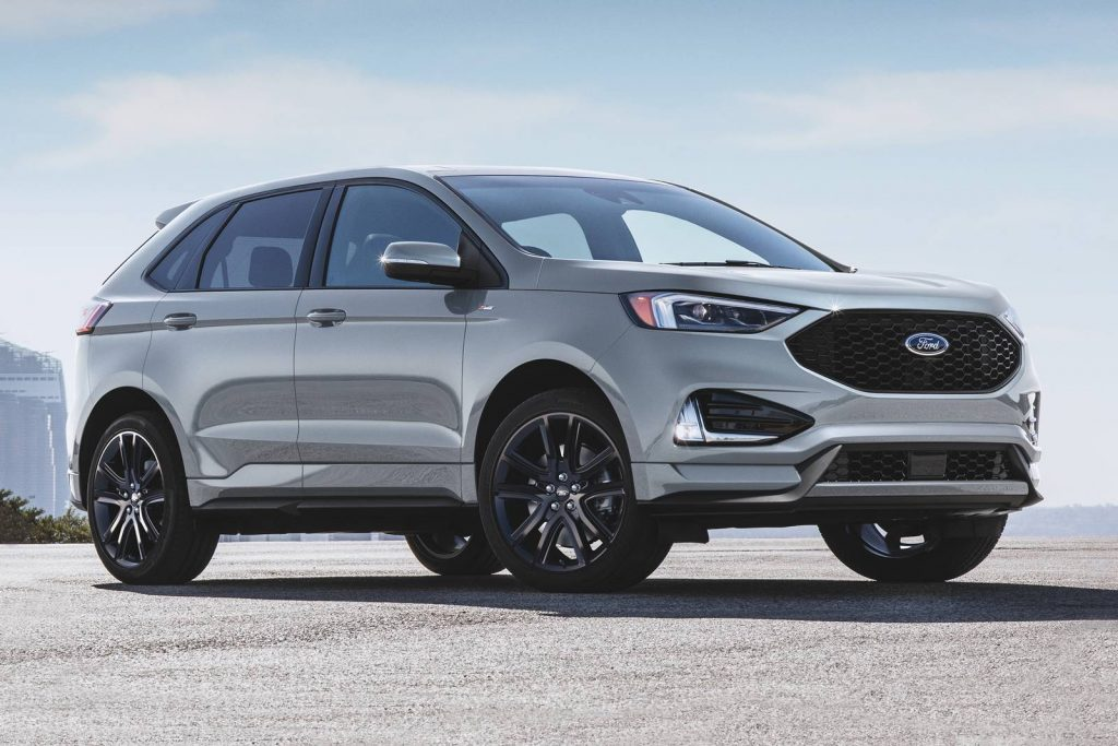 A grey 2020 Ford Edge on the track.