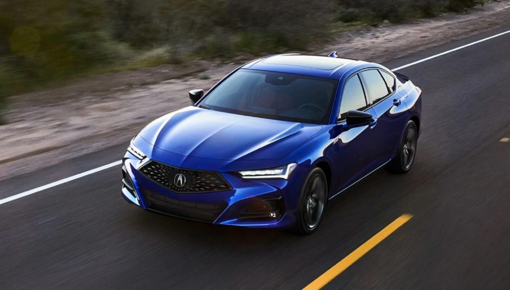 A blue 2021 Acura TLX A-Spec drives down the road