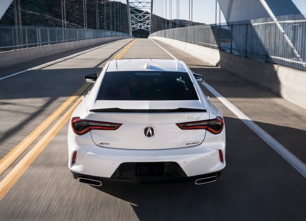 The rear view of a white 2021 Acura TLX A-Spec AWD on a bridge