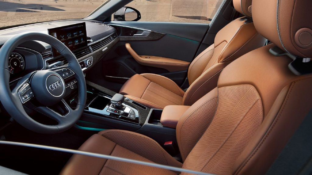 The 2021 Audi A4's brown-leather front seats and black dashboard