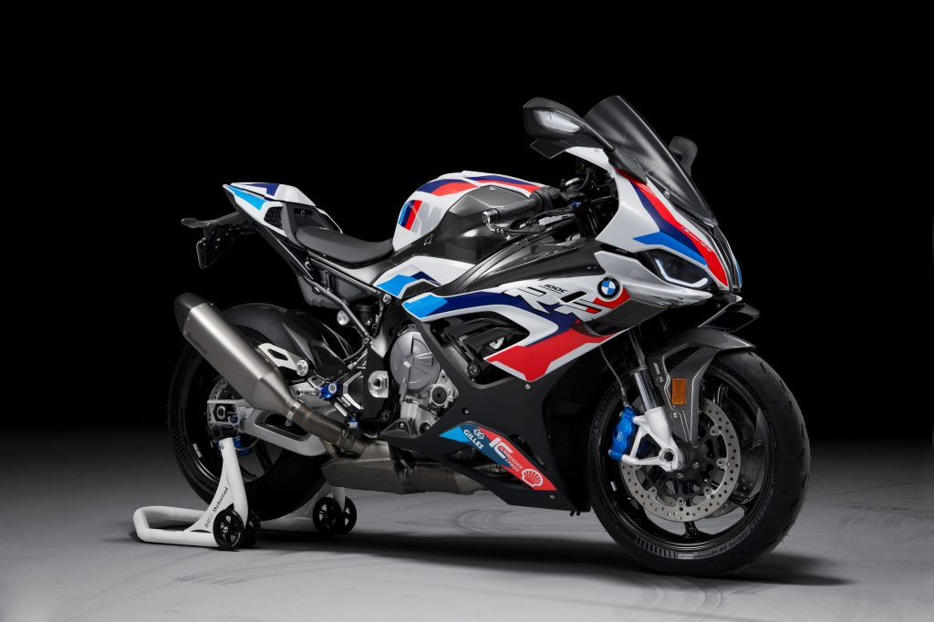 A white-red-and-blue 2021 BMW M 1000 RR on a rear-wheel stand