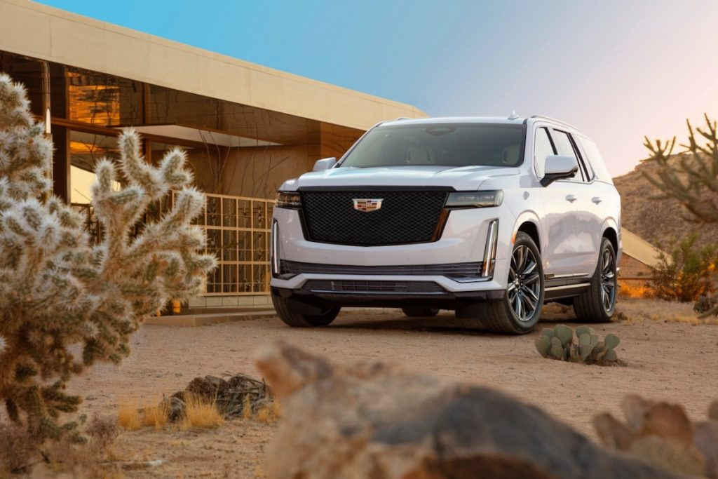 2021 Cadillac Escalade luxury SUV parked in a desert landscape with a cactus