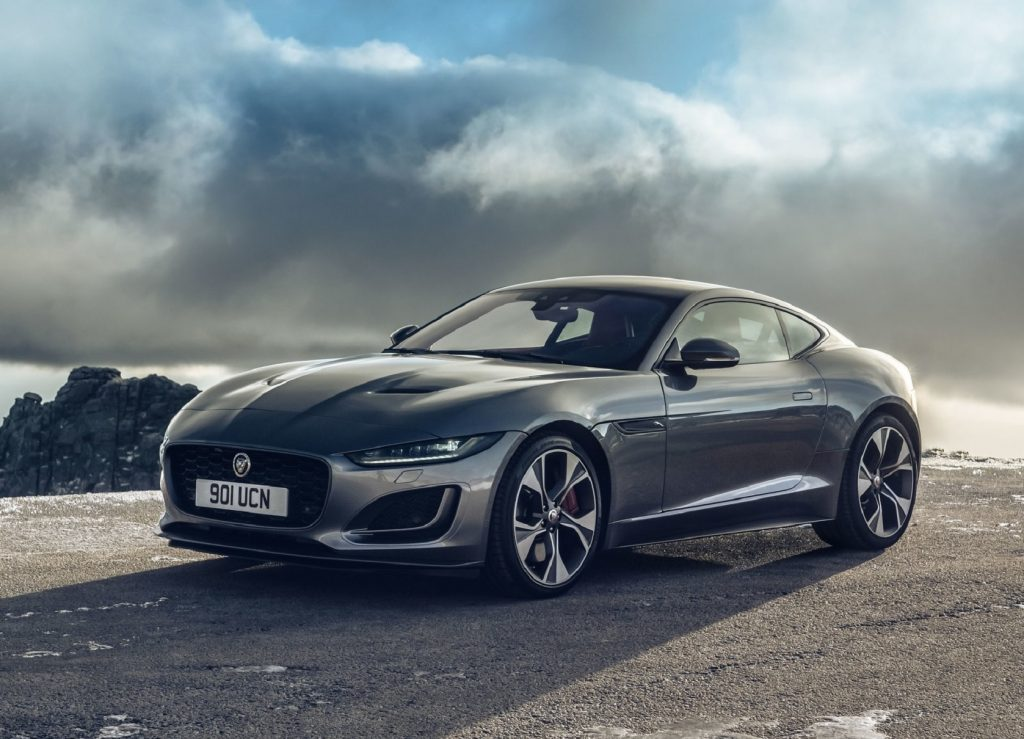 A gray 2021 Jaguar F-Type Coupe in front of the ocean