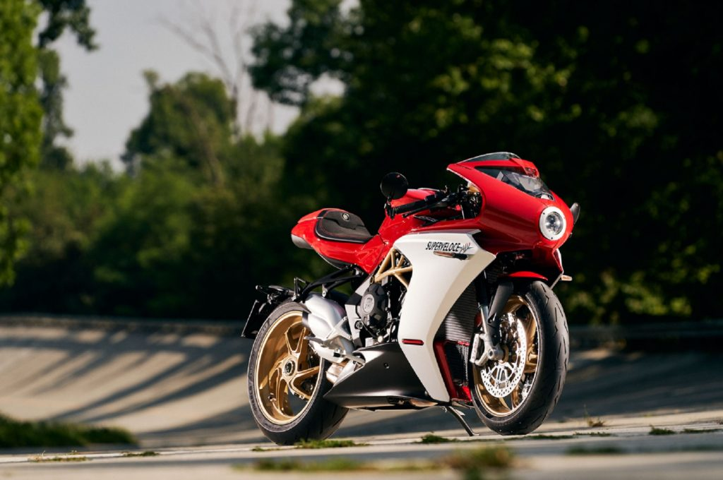 A red-and-white 2021 MV Agusta Superveloce 800 on a tree-lined racetrack