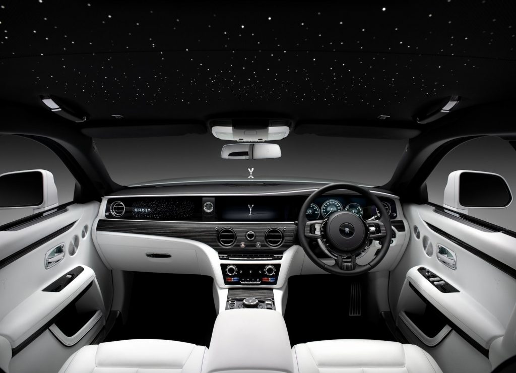 A white-leather-upholstered 2021 Rolls-Royce Ghost's interior, showing the LED-lit headliner