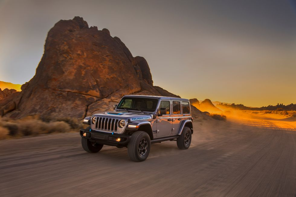 Jeep Wrangler 4xe driving on dirt road
