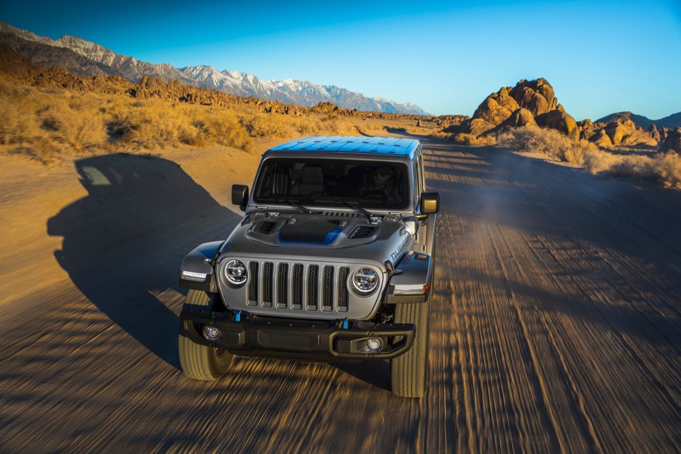 2021 Jeep Wrangler 4xe driving on dirt road