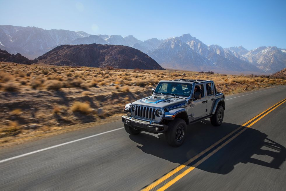 2021 Jeep Wrangler 4xe driving on wilderness road