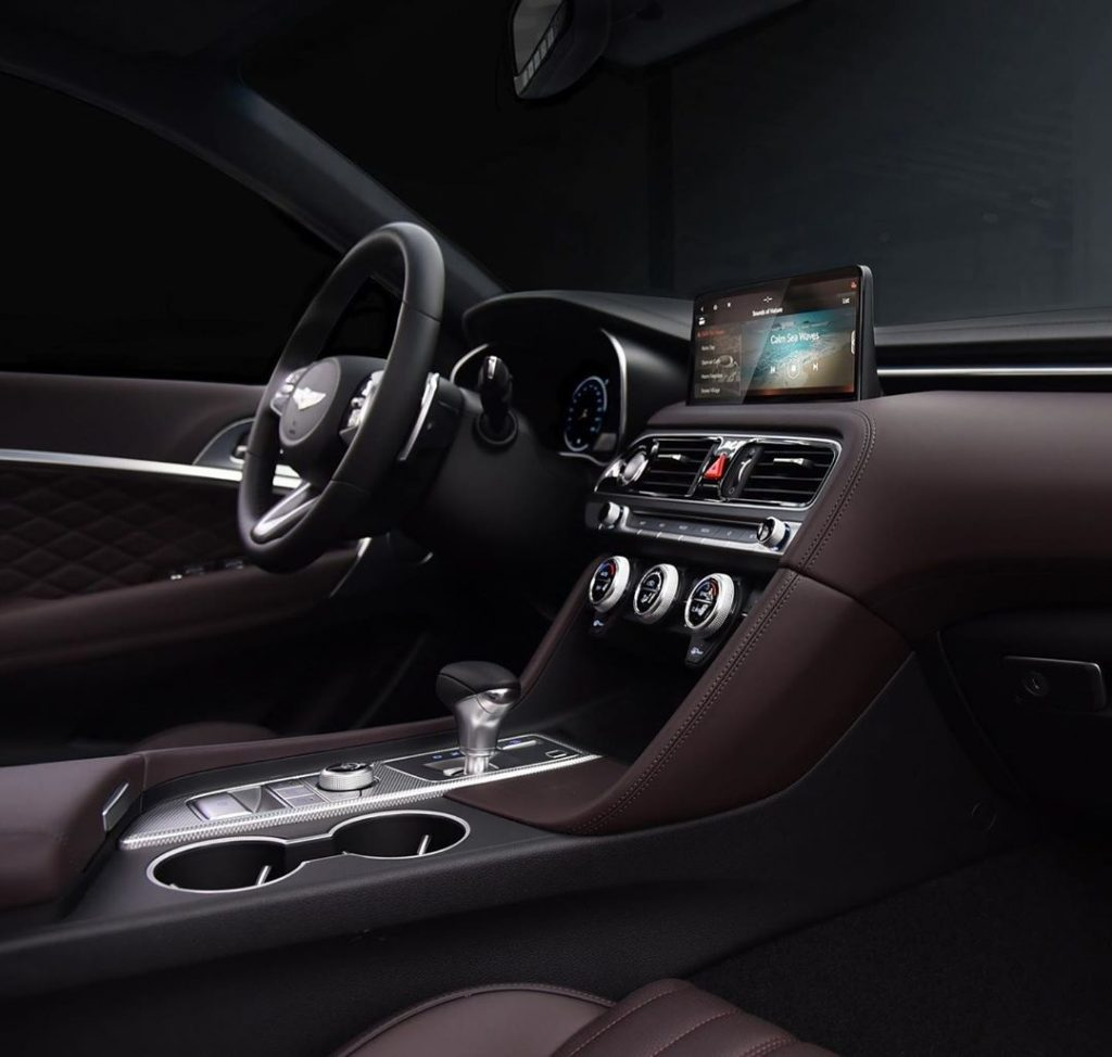The dark-brown-leather-upholstered interior of the 2022 Genesis G70