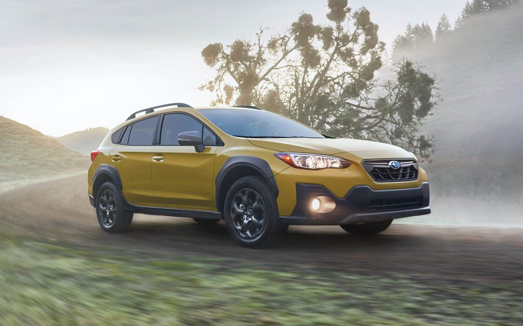 A yellow 2021 Subaru Crosstrek Sport on a foggy field