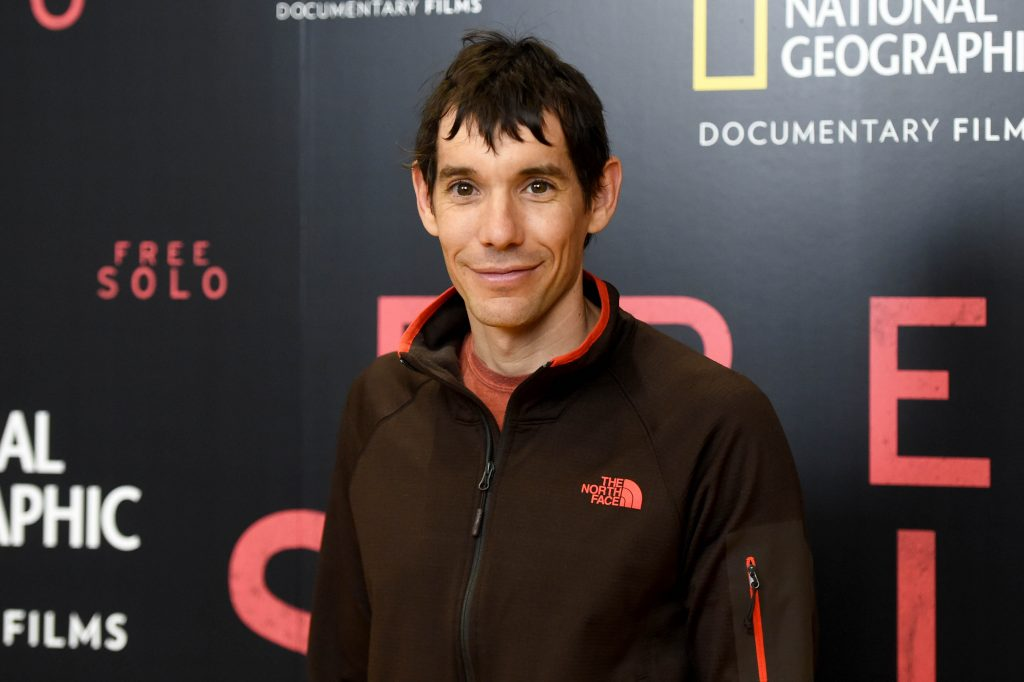 Alex Honnold posing for a photo at the premiere of a documentary