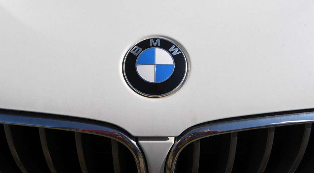 Close-up of the BMW logo on the hood of a car