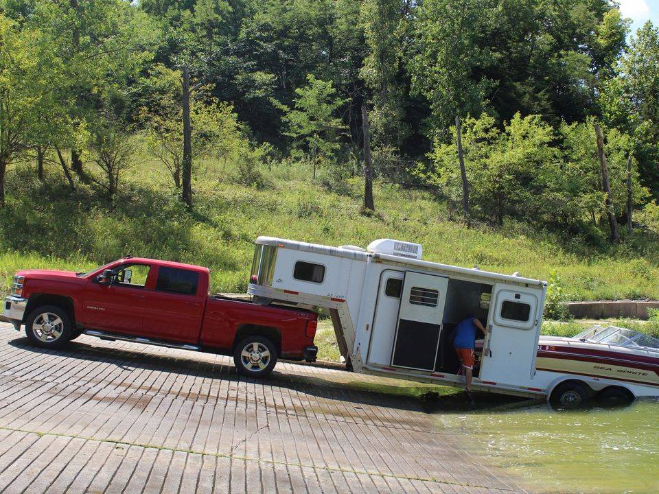 The boat and camper RV trailer at the boat launch.