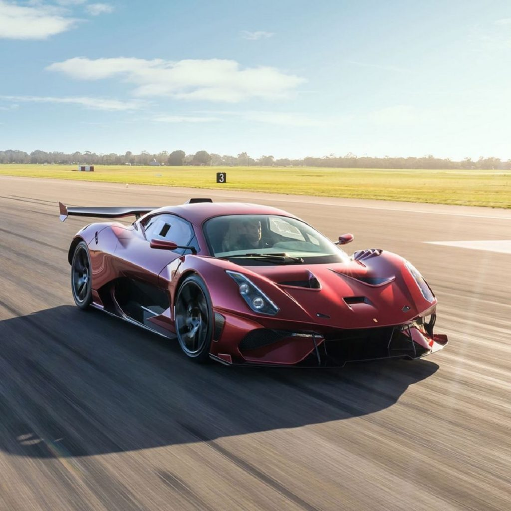 A red Brabham BT62R races down a runway