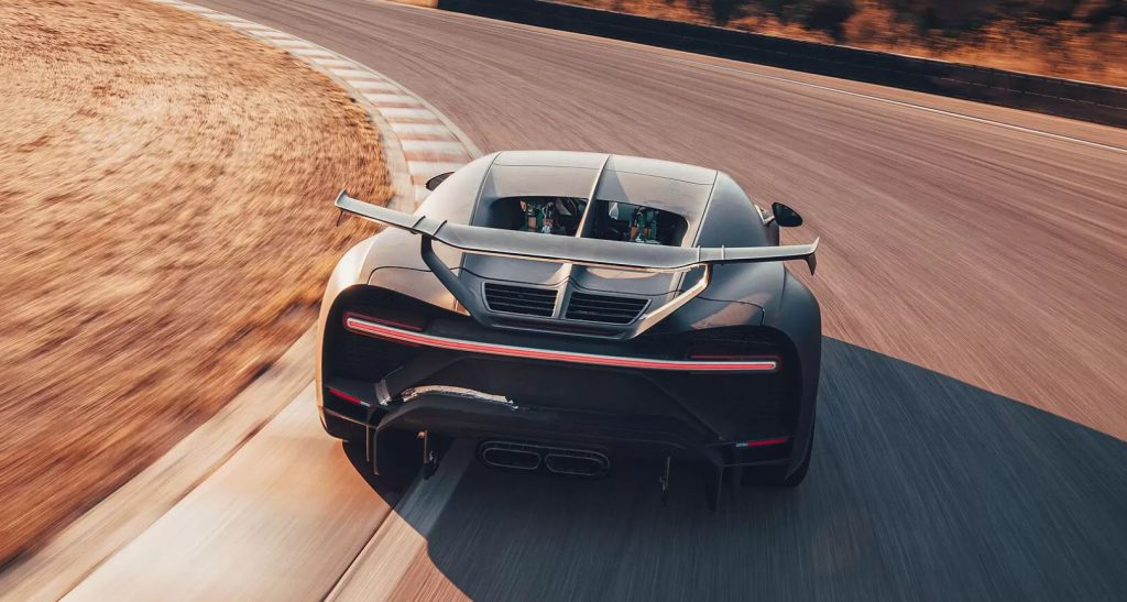 The Bugatti Chiron Pur Sport rounds a turn at a racetrack.