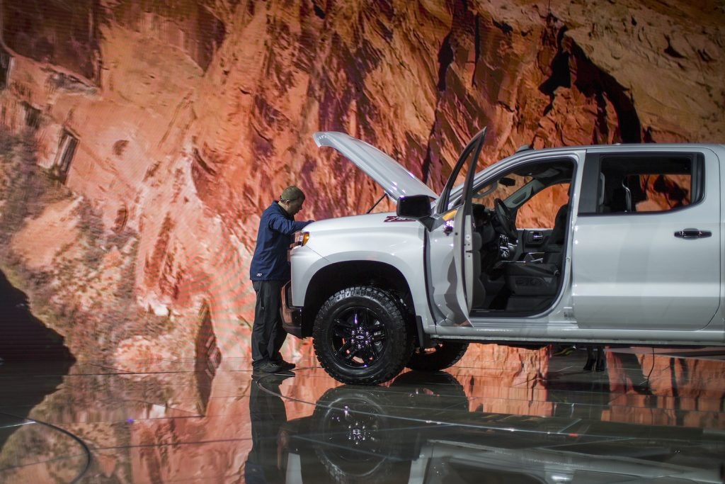 A man looks at a Chevrolet Silverado truck at the auto trade show, AutoMobility LA