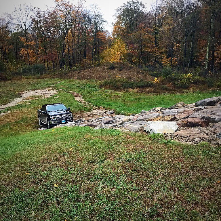 A Ford F-150 waits at the bottom of Consumer Reports' rocky test hill