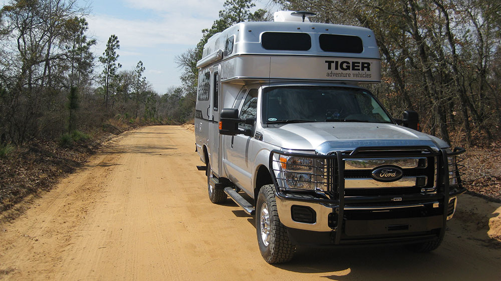 Bengal off-road pickup truck RV by Tiger Adventure Vehicles on a dirt road