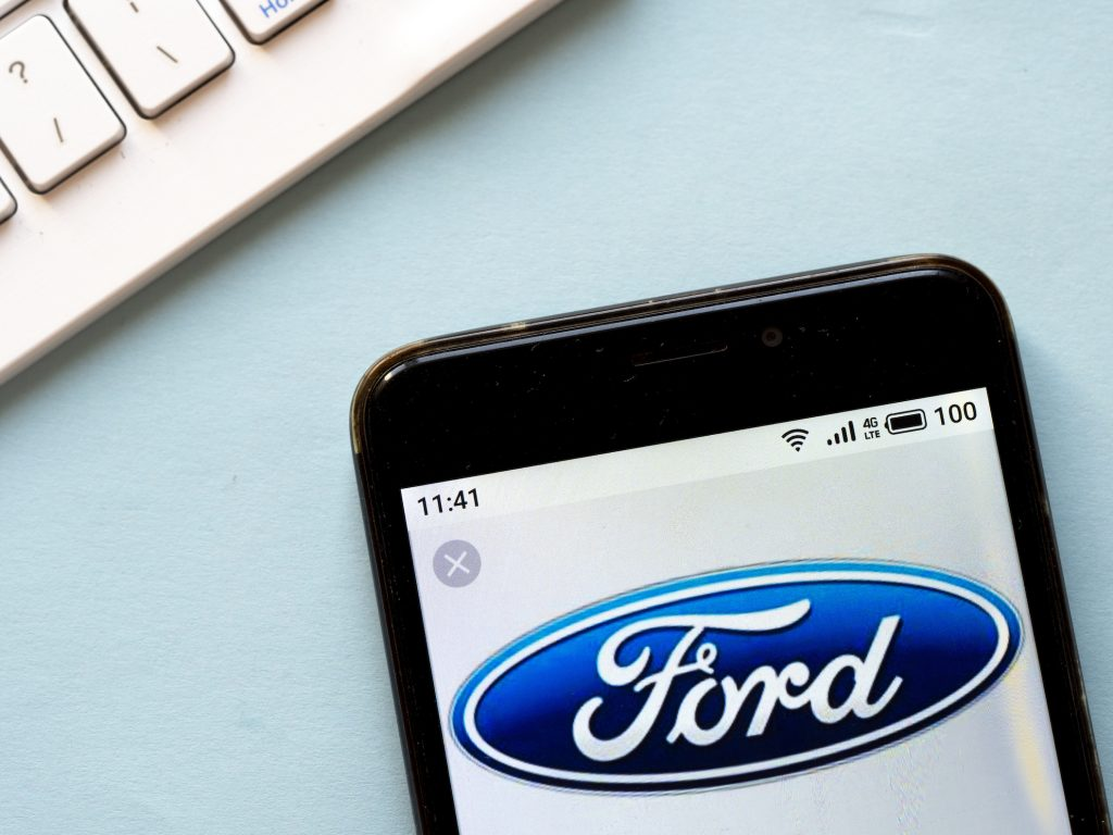 In this photo illustration a Ford logo seen displayed on a smartphone.