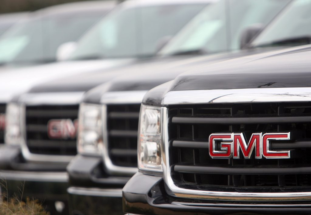 GMC Sierra trucks on display at a dealership