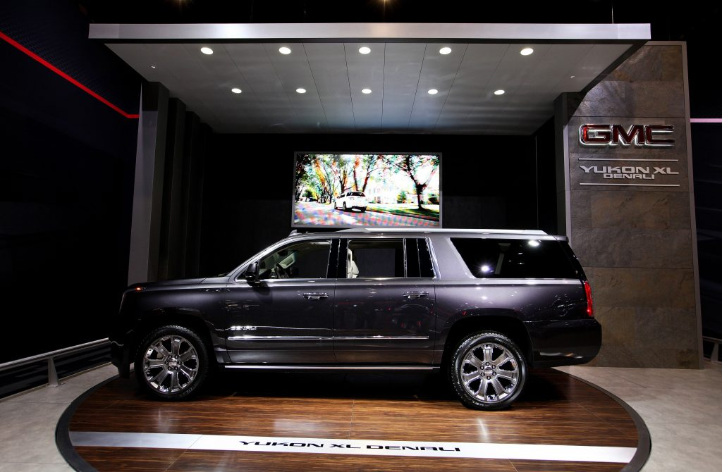 A GMC Yukon XL Denali on display at an auto show