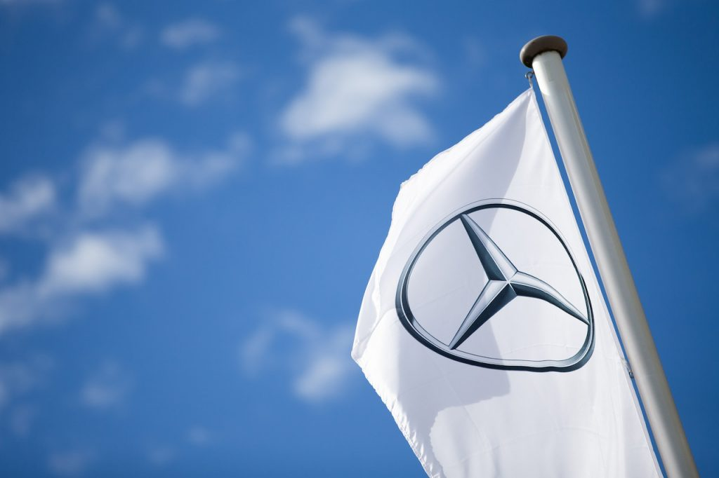 A close up image of the Mercedes-Benz logo