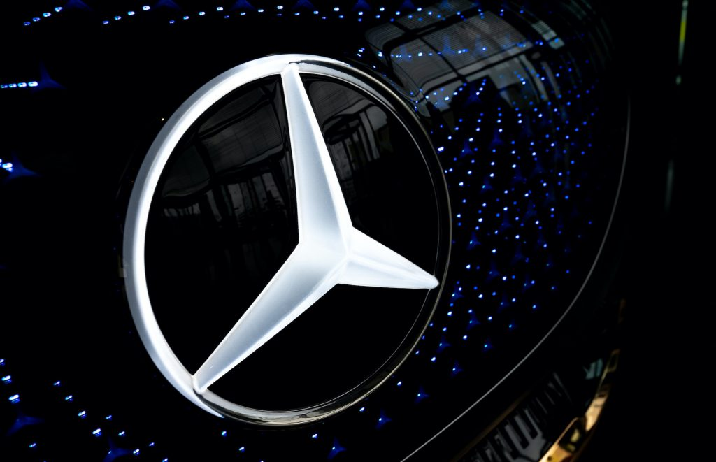 A photo of the Mercedes three-pointed star logo.