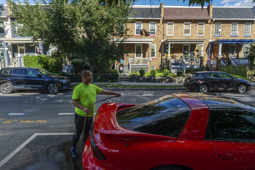 John Branscomb washes his car in the Barney Circle neighborhood in Washington, DC, on August 30, 2020.