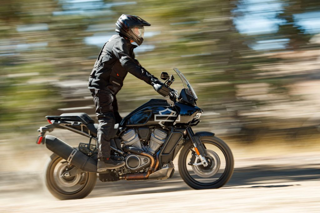 A rider takes the Harley-Davidson Pan America concept through a forest