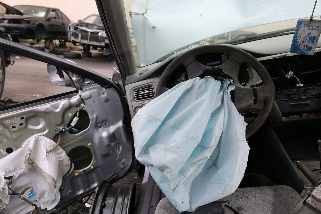 A deployed airbag is seen in a 2001 Honda Accord