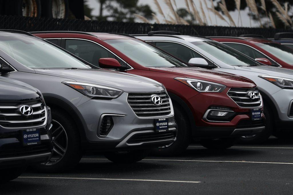 Row of Hyundai Santa Fe models outside a dealership