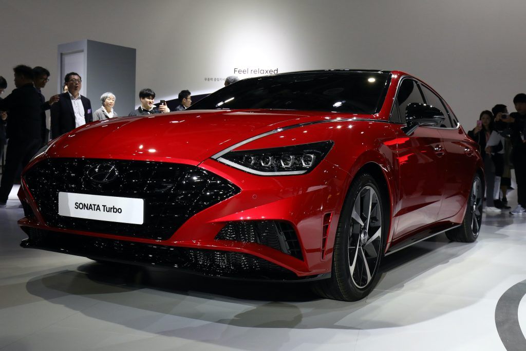 People view the Hyundai Motor SONATA during the Seoul Motor Show 2019 at KINTEX
