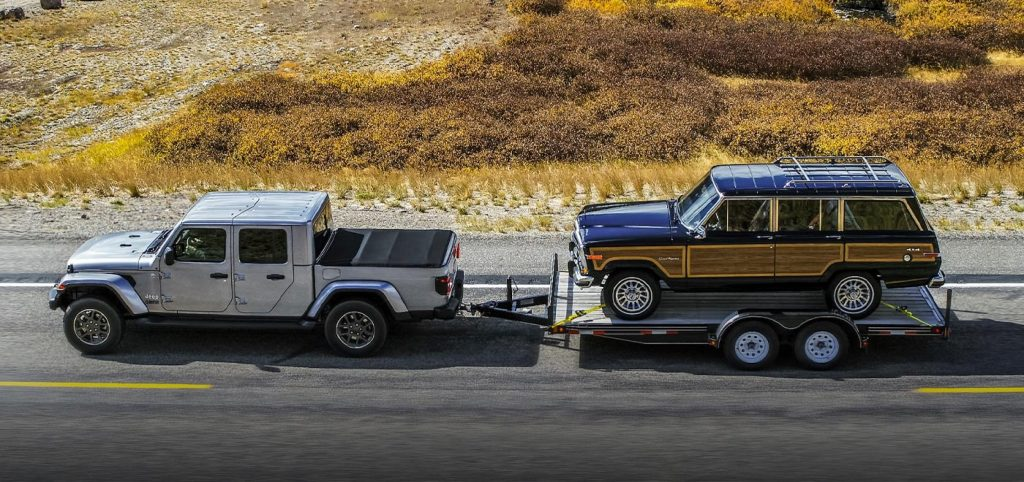 2021 Jeep Gladiator hauling a classic Jeep Wagoneer