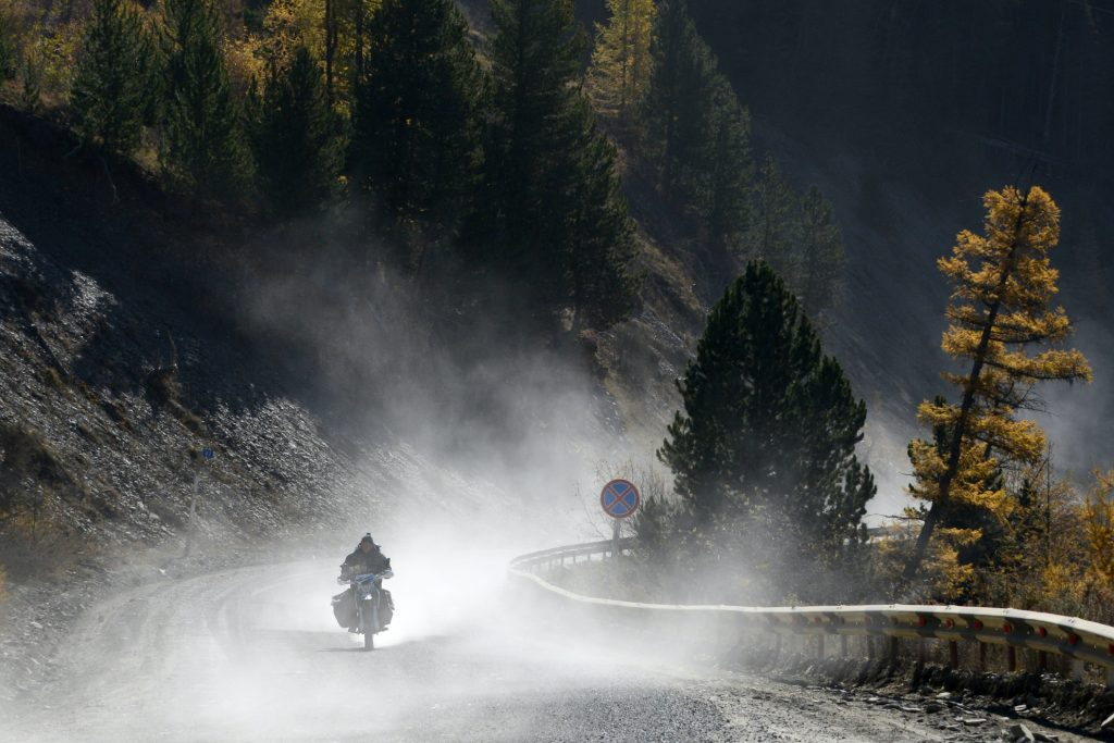 A man rides a motorcycle in the Ulagan District.