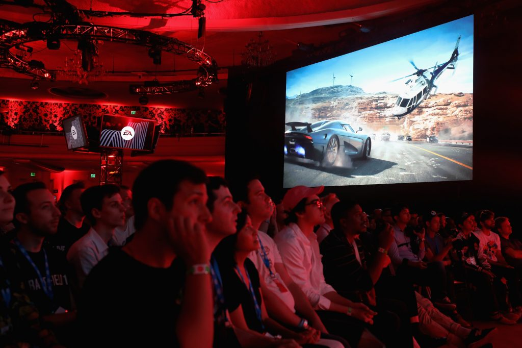 An audience watches debut footage of the PS4 video game Need for Speed Payback at E3.