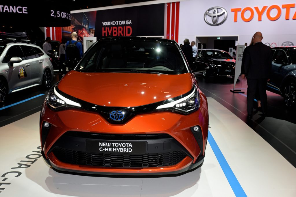 A Toyota C-CHR Hybrid on display at an auto show