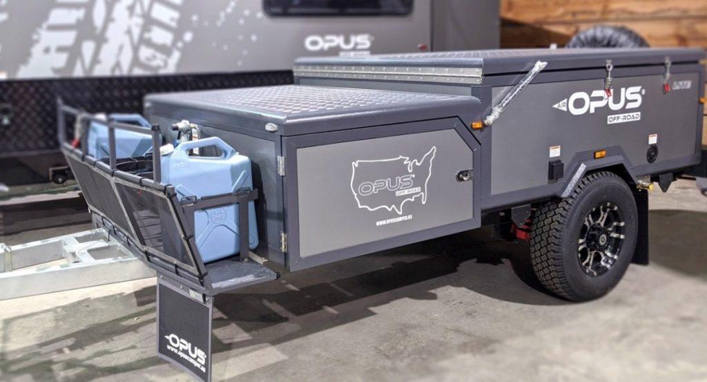 A grey Opus Lite trailer at a campsite.