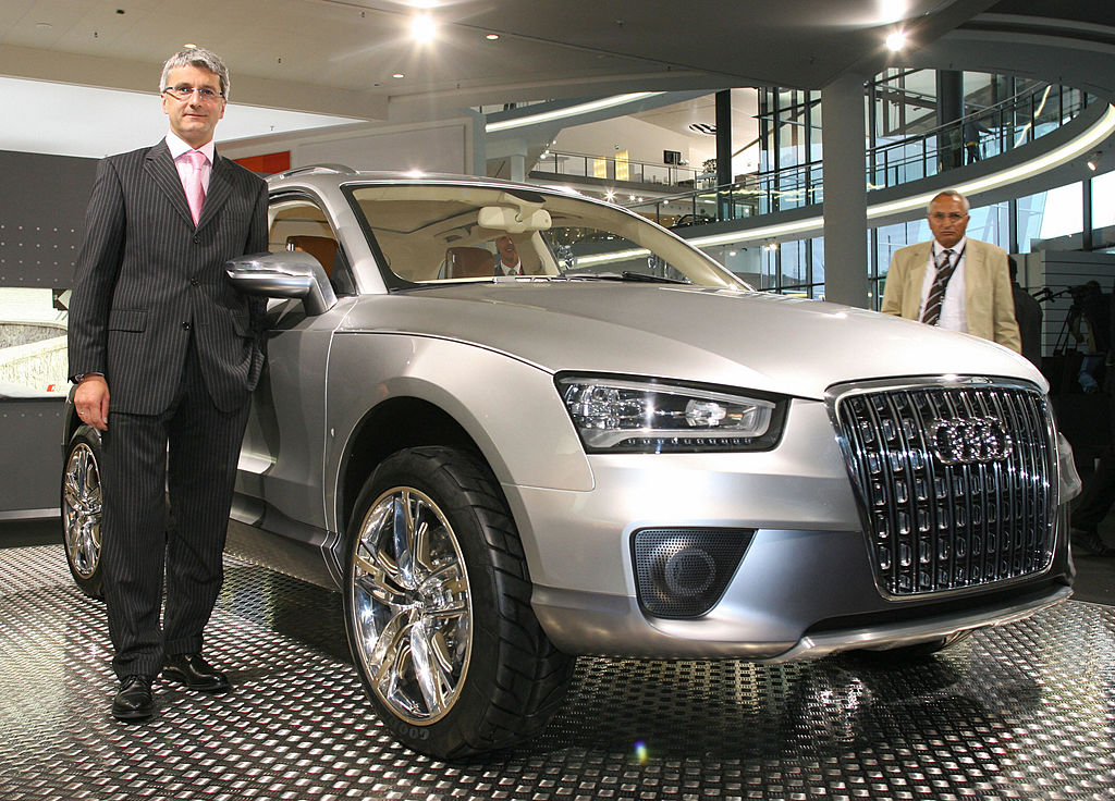 Neckarsulm, GERMANY: Chairman of German car maker Audi Rupert Stadler poses next to an Audi Q7 model prior to an annual general meeting in Neckarsulm 09 May 2007. Stadler said earlier he expected Volkswagen's Audi brand to surpass its 2006 results. AFP PHOTO MICHAEL LATZ     GERMANY OUT  (Photo credit should read MICHAEL LATZ/DDP/AFP via Getty Images)