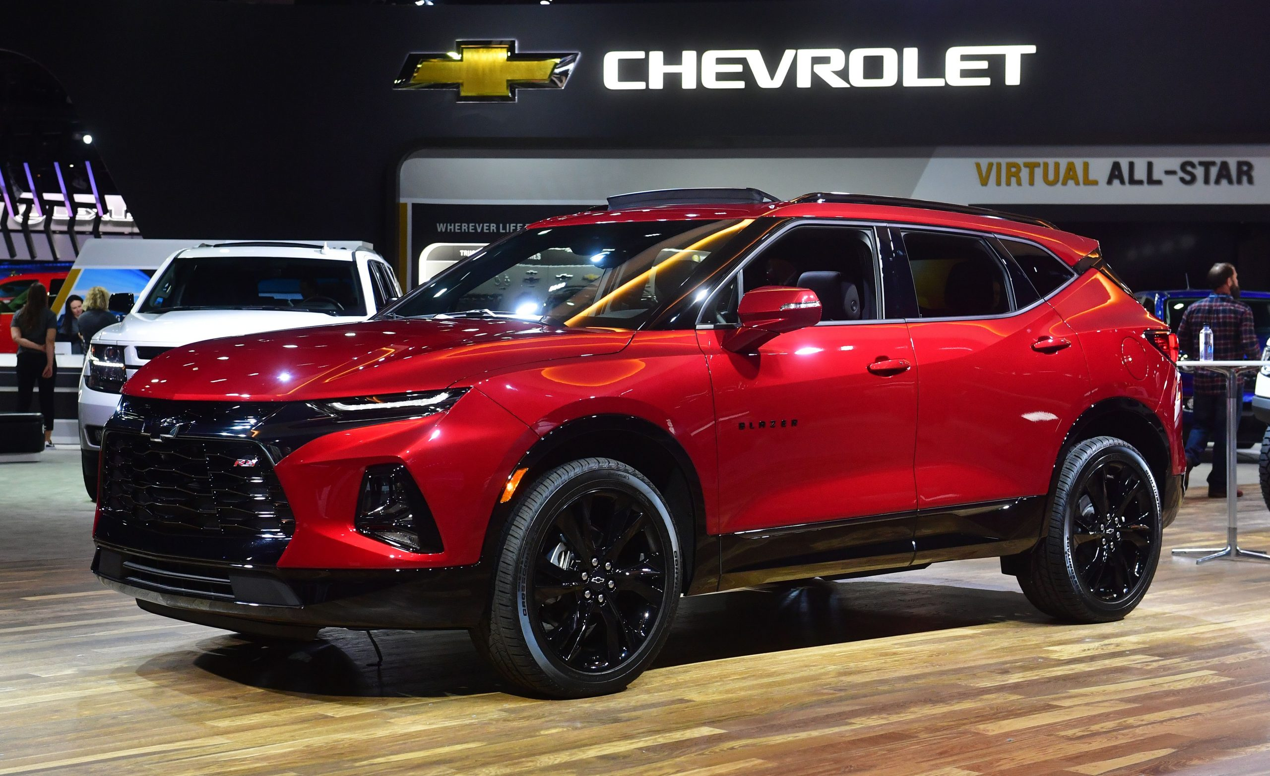 a red Chevy Blazer on display at an auto show