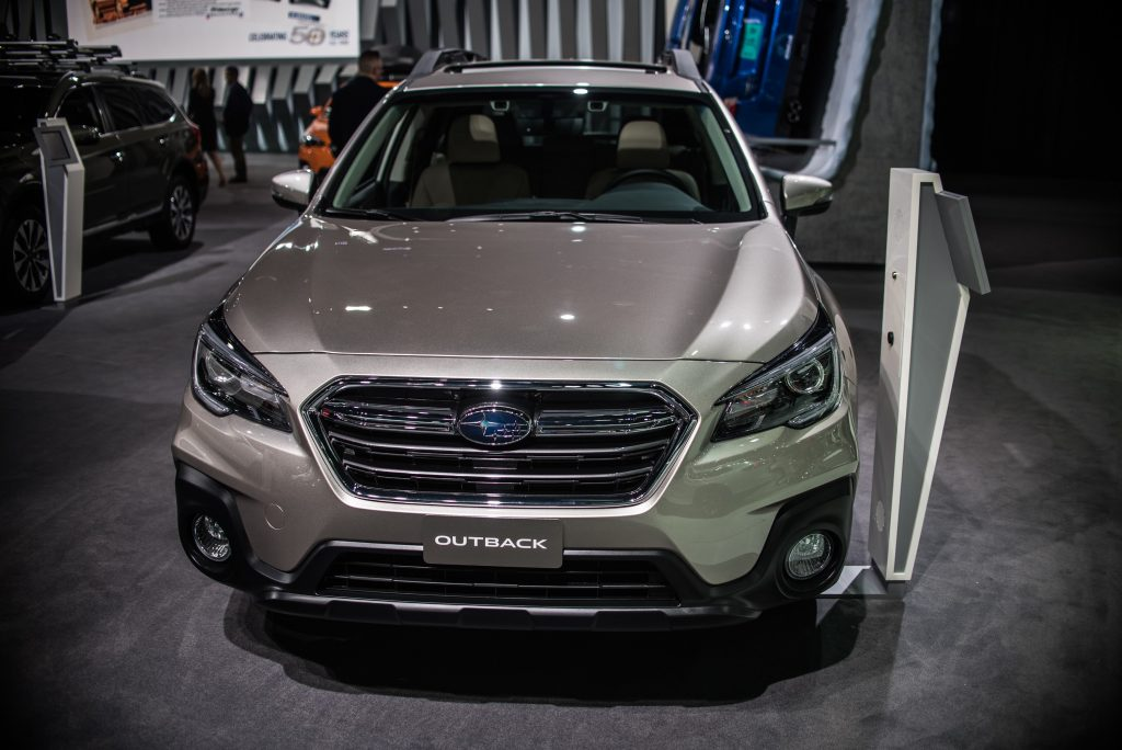 A Subaru Outback on display at an auto show
