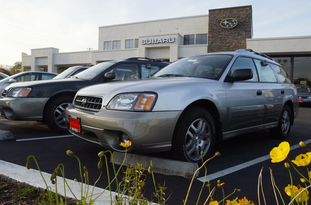 Subaru SUVs on display at a car dealership