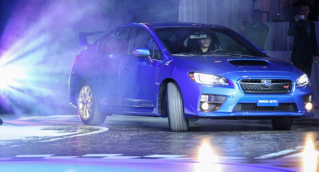 A Subaru WRX STI on display at an auto show