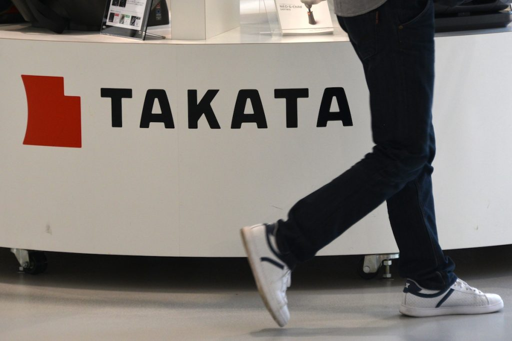 Takata airbags logo with someone walking by