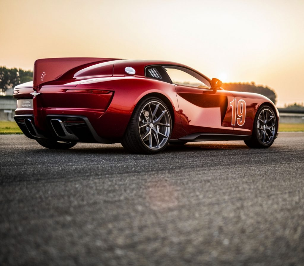 The rear 3/4 of the Touring Superleggera Aero 3 on a racetrack at sunset
